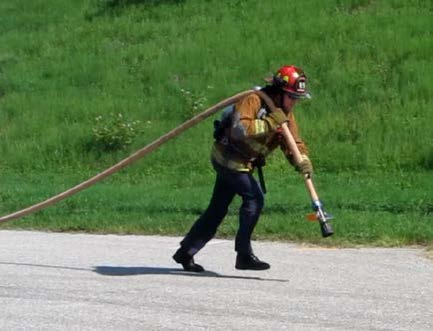"Applicant pulling a charged 1 3/4"" hose a distance of 100 feet"