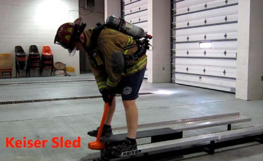 Applicant using eight pound hammer to drive a beam a distance of 5 feet on keiser sled