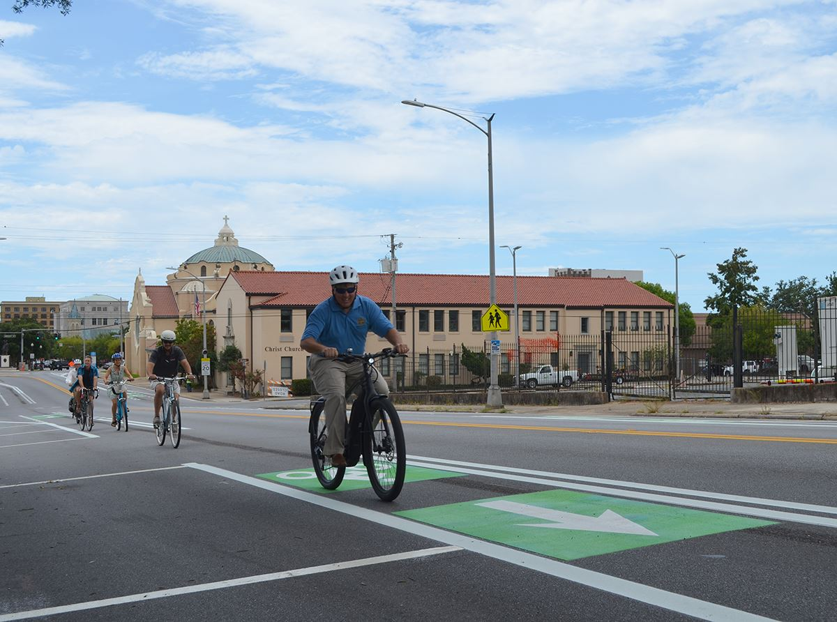 Mayor Grover Robinson rides his bike in the new bike lane along Palafox Street