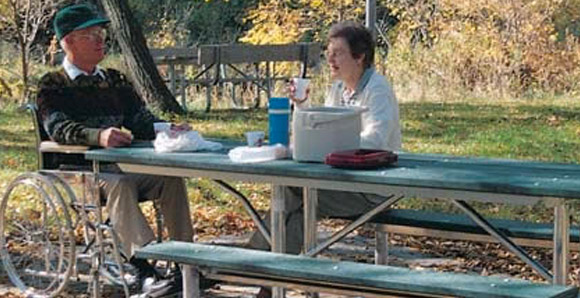 Couple eating at a picnic table